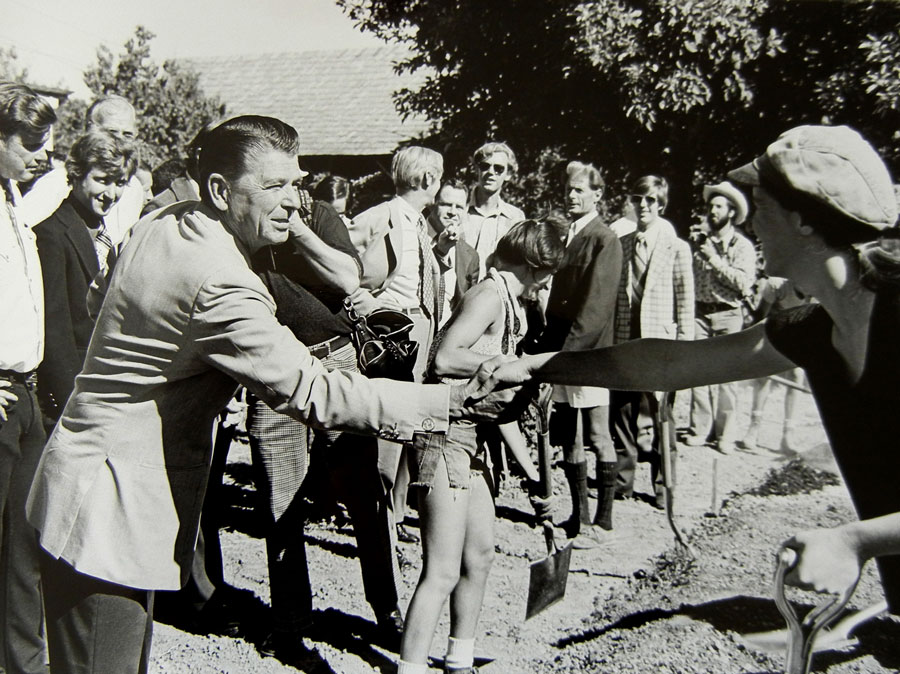 Governor Ronald Reagan greats an apprentice at the Alan Chadwick Garden in Covelo